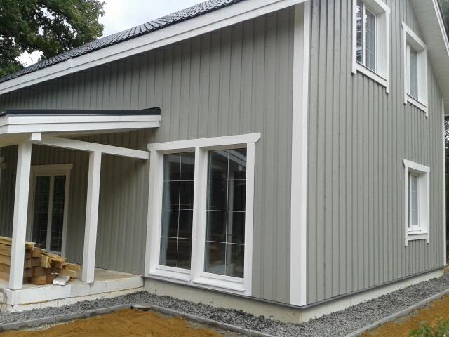 Каркасный дом 7х11: отделка фасада и мягкая отмостка