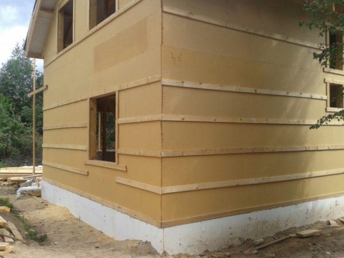Каркасный дом 7х11: обшивка стен изоплатом